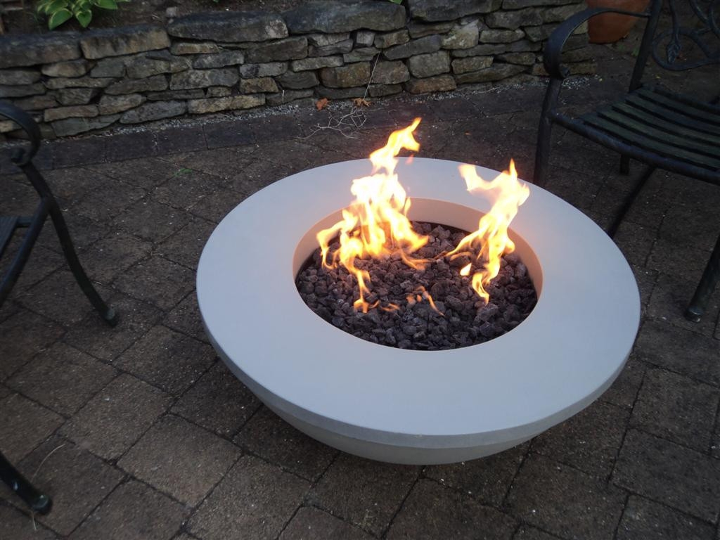 today's modern outdoor fire pits  fire tables  the fireplace place - as if those things weren't enough adding a fire pit to your backyard canalso increase your home's resale value if you ever decide to sell